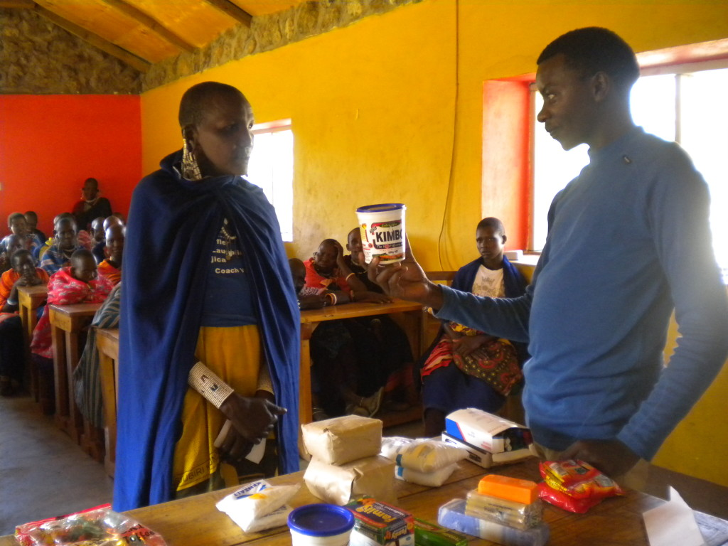 A Maasai participant buys  groceries during a shopping exercise.