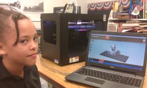 A young student in Southern Illinois learns about 3-D printing.