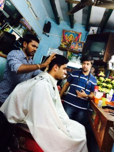 Photo of Karan Sinha and Shashank Gaur in a barbershop, by Amy Restko and Quinn Qin